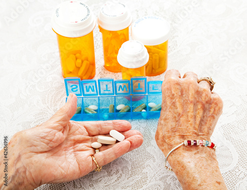 Elderly Hands Sorting Pills