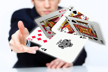 Young man showing poker cards