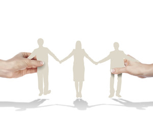 Three people standing and holding hands