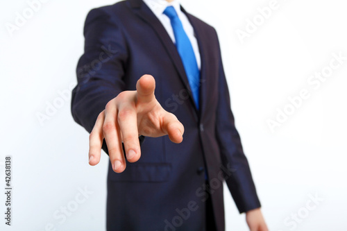 Businessman pushing a button with his finger