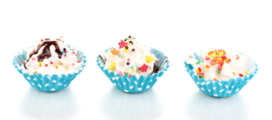 Creamy cupcakes isolated on white