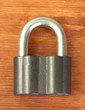 old padlock on wooden background close-up