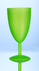Bright plastic goblet on blue background