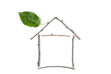 Ecological house made up of branches and green leaf
