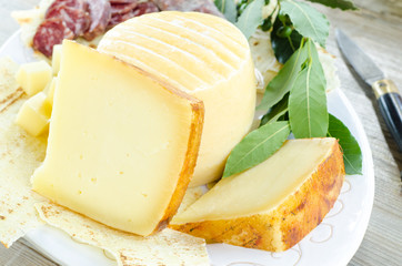 Slices of pecorino sardo, typical cheese from Sardinia
