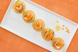 """Red salmon rolls with cheese, caviar and cucumber on"""" blinis"""""""