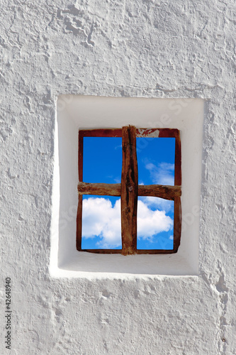 Balearic islands blue sky view through window