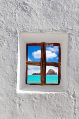 Ibiza Es vedra island view through white window