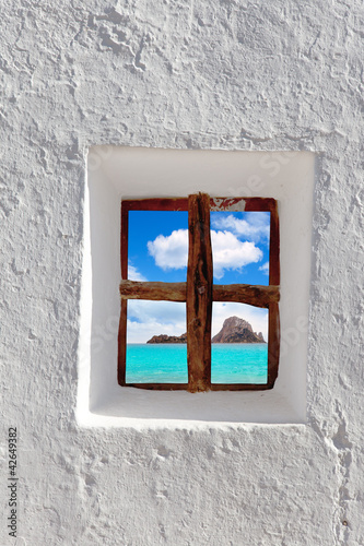 Ibiza Es vedra island view through white window