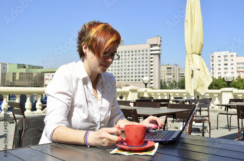 business woman drinking coffee at outdoor cafe