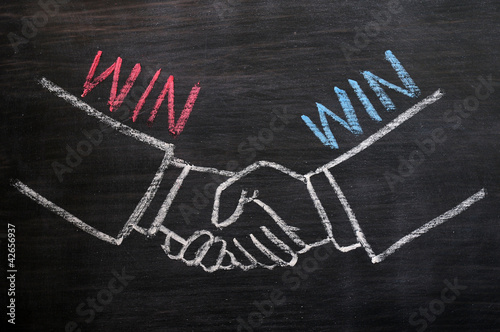 Mutual benefit concept of handshaking on blackboard