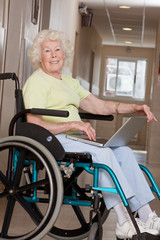 Woman on Wheelchair Using Laptop