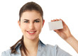 Portrait of a joyful young woman showing blank business card