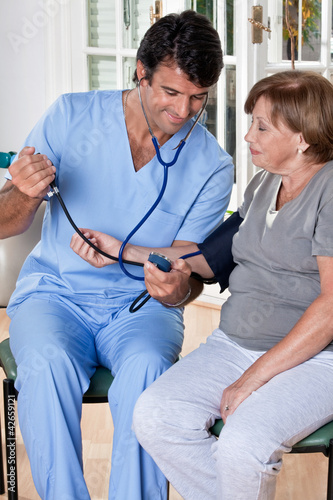 Doctor taking the Blood Pressure