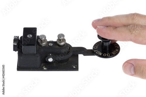 Telegraph key with hand operating it