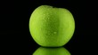 Green apple with water drops