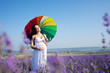 Pregnant woman on lavender field