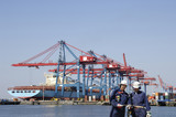 large container port with dock workers in foreground