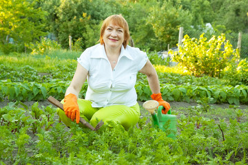 woman working in field of carrot