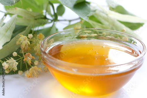Golden honey in a transparent bowl