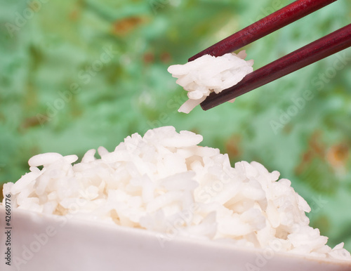 Rice in a bowl with Chinese chopsticks