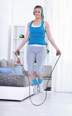 Fitness girl jump rope