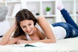teenager girl learning on floor