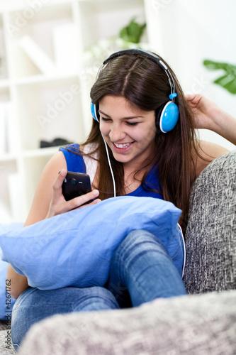 pretty happy girl listening to music