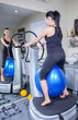 beautiful woman on trainer machine in sport gym