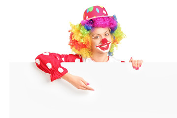 Female clown with happy joyful expression on her face posing beh
