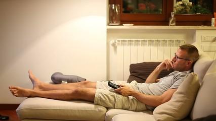 A boy watching tv on sofa