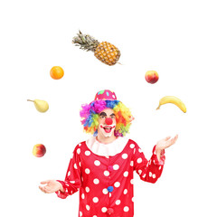 A smiling clown juggling fruits