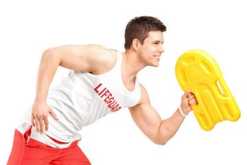 A young lifeguard running