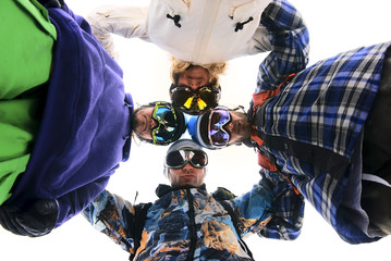 Snowboarders in circle looking down