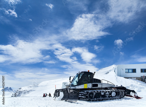 Snowcat in mountains