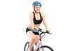Smiling female biker with helmet sitting on a bike