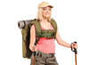 A woman in sportswear with backpack and hiking poles