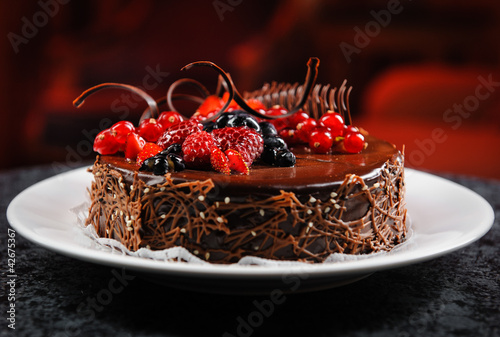 Luscious chocolate cake with berries