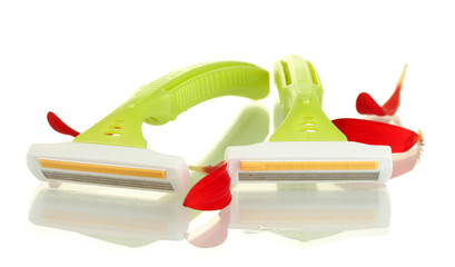 woman safety shavers and red petals isolated on white.