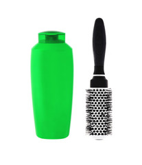 Green shampoo bottle and hairbrush isolated on white