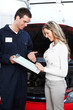 Auto mechanic and a client woman.
