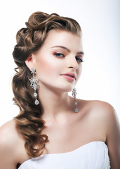 Beautiful bride in white dress. Festive coiffure and makeup