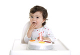 Baby eating his birthday cake