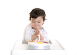 Baby looking excited at his first cake
