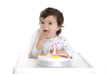 Baby eating his birthday cake