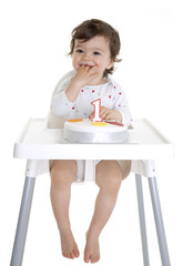 Baby and his first birthday cake