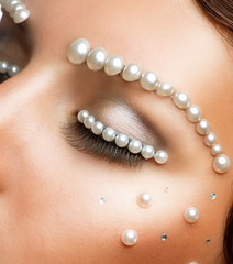 Creative Makeup With Pearls. Beautiful Young Woman Portrait