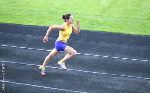 Girl running on the track