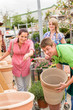 Customers choose flower pots in garden center