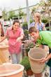 Customers choose flower pots in garden center